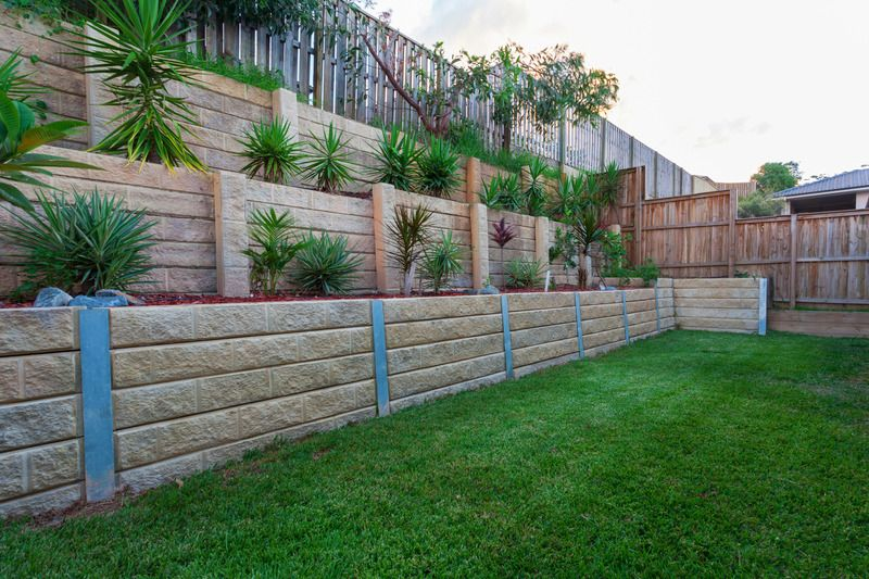Stone and wooded retaining walls, large steps with plants installed - Mornington