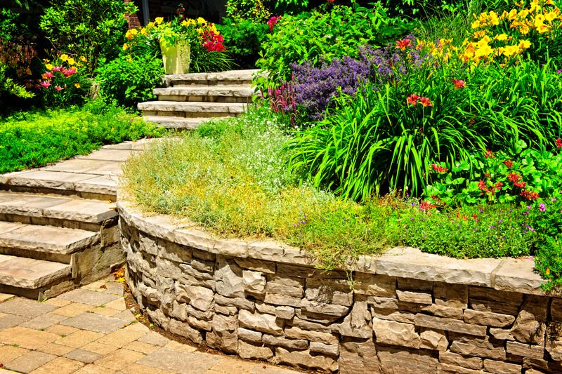 Natural stone retaining walls with garden bed job - Mornington 2