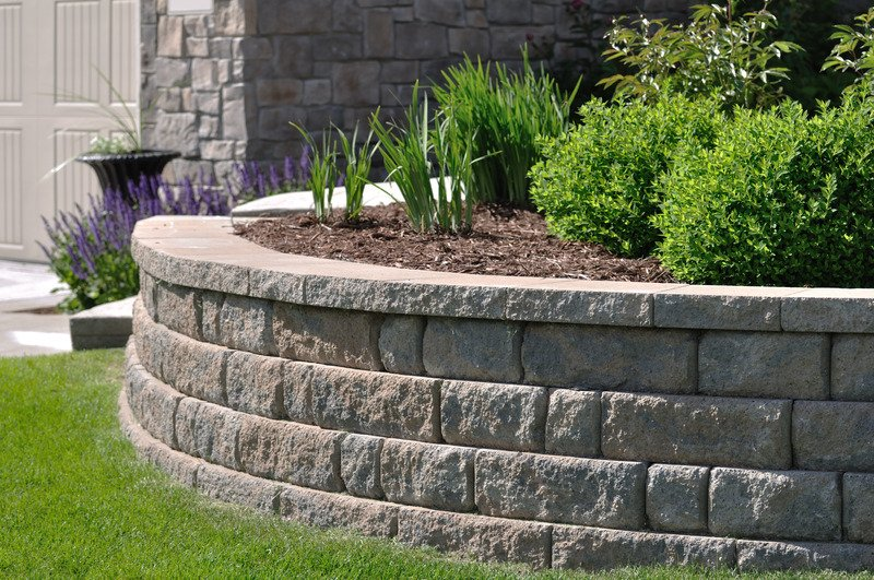 Natural stone retaining wall with garden bed - Mornington Victoria